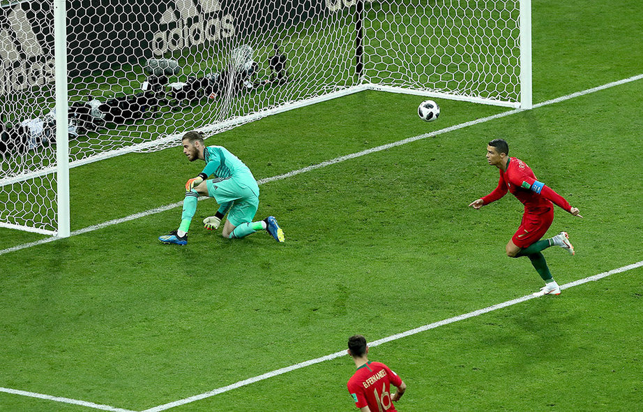 Sochi (Russian Federation), 15/06/2018.- Cristiano Ronaldo of Portugal scores by penalty the 1-0 during the FIFA World Cup 2018 group B preliminary round soccer match between Portugal and Spain in Sochi, Russia, 15 June 2018. (RESTRICTIONS APPLY: Editorial Use Only, not used in association with any commercial entity - Images must not be used in any form of alert service or push service of any kind including via mobile alert services, downloads to mobile devices or MMS messaging - Images must appear as still images and must not emulate match action video footage - No alteration is made to, and no text or image is superimposed over, any published image which: (a) intentionally obscures or removes a sponsor identification image; or (b) adds or overlays the commercial identification of any third party which is not officially associated with the FIFA World Cup) (España, Mundial de Fútbol, Rusia) EFE/EPA/MOHAMED MESSARA EDITORIAL USE ONLY EDITORIAL USE ONLY