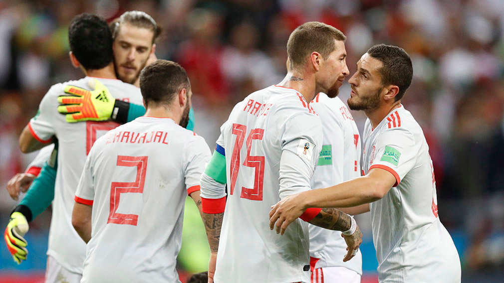 Kazan (Russian Federation), 20/06/2018.- Sergio Ramos (2-L) of Spain and his team mate Koke (L) react after the FIFA World Cup 2018 group B preliminary round soccer match between Iran and Spain in Kazan, Russia, 20 June 2018. Spain won the match 1-0. (RESTRICTIONS APPLY: Editorial Use Only, not used in association with any commercial entity - Images must not be used in any form of alert service or push service of any kind including via mobile alert services, downloads to mobile devices or MMS messaging - Images must appear as still images and must not emulate match action video footage - No alteration is made to, and no text or image is superimposed over, any published image which: (a) intentionally obscures or removes a sponsor identification image; or (b) adds or overlays the commercial identification of any third party which is not officially associated with the FIFA World Cup) (España, Mundial de Fútbol, Rusia) EFE/EPA/ROBERT GHEMENT EDITORIAL USE ONLY