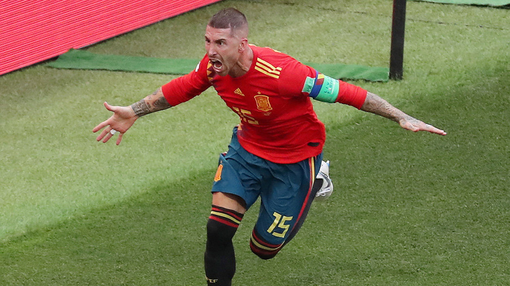 Moscow (Russian Federation), 01/07/2018.- Sergio Ramos of Spain celebrates the 1-0 lead during the FIFA World Cup 2018 round of 16 soccer match between Spain and Russia in Moscow, Russia, 01 July 2018. (RESTRICTIONS APPLY: Editorial Use Only, not used in association with any commercial entity - Images must not be used in any form of alert service or push service of any kind including via mobile alert services, downloads to mobile devices or MMS messaging - Images must appear as still images and must not emulate match action video footage - No alteration is made to, and no text or image is superimposed over, any published image which: (a) intentionally obscures or removes a sponsor identification image; or (b) adds or overlays the commercial identification of any third party which is not officially associated with the FIFA World Cup) (España, Mundial de Fútbol, Moscú, Rusia) EFE/EPA/ABEDIN TAHERKENAREH EDITORIAL USE ONLY