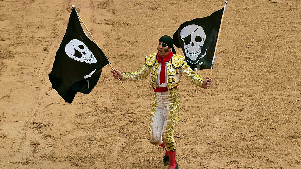 The cape of Spanish bullfighter Juan Jose Padilla is seen as he is brought out of the bullring on people's shoulders following his performance in a bullfight at the San Fermin festival in Pamplona, Spain, July 13, 2018.  (AP Photo/Alvaro Barrientos)