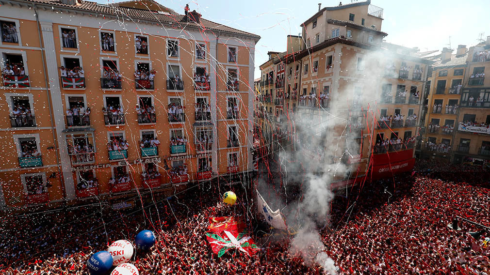 Revellers hold up the traditional red scarves during the firing of 'chupinazo', which opens the San Fermin festival in Pamplona Spain, July 6, 2019