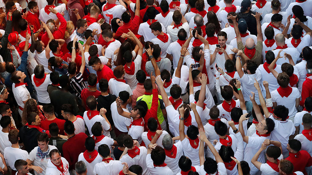 Runners wait for the start of the running of the bulls at the San Fermin festival in Pamplona, Spain, July 12, 2019. REUTERS/Susana Vera
