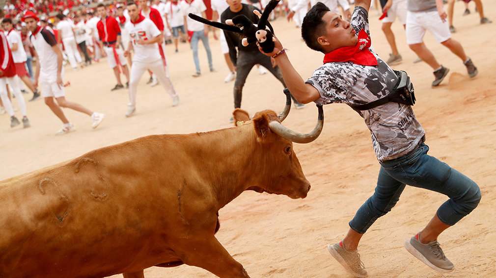 A reveller is being hit on the bullring during the running of the bulls at the San Fermin festival in Pamplona, Spain, July 14, 2019.   *** Local Caption *** .