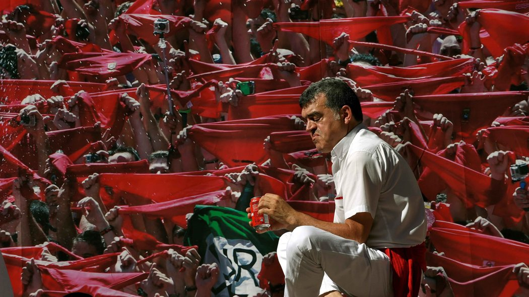 A reveller celebrates during the start of the San Fermin festival in Pamplona, Spain July 6, 2016. REUTERS/Eloy AlonsoCODE: X01457
