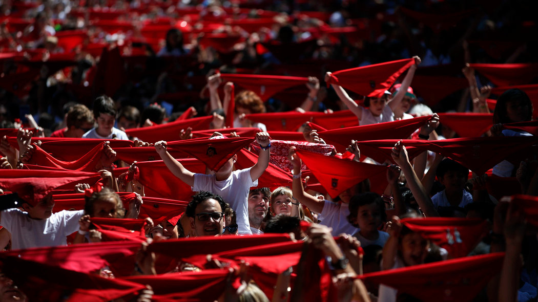 "Sergio Colas (C), his daughter Alaia and wife Alma take part in the traditional ""Chupinazo"" rocket launch during the start of the San Fermin festival in Pamplona, northern Spain, July 6, 2016."