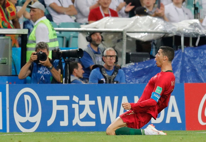 Sochi (Russian Federation), 15/06/2018.- Cristiano Ronaldo of Portugal celebrates after scoring the 2-1 lead during the FIFA World Cup 2018 group B preliminary round soccer match between Portugal and Spain in Sochi, Russia, 15 June 2018. (RESTRICTIONS APPLY: Editorial Use Only, not used in association with any commercial entity - Images must not be used in any form of alert service or push service of any kind including via mobile alert services, downloads to mobile devices or MMS messaging - Images must appear as still images and must not emulate match action video footage - No alteration is made to, and no text or image is superimposed over, any published image which: (a) intentionally obscures or removes a sponsor identification image; or (b) adds or overlays the commercial identification of any third party which is not officially associated with the FIFA World Cup) (España, Mundial de Fútbol, Rusia) EFE/EPA/RONALD WITTEK EDITORIAL USE ONLY