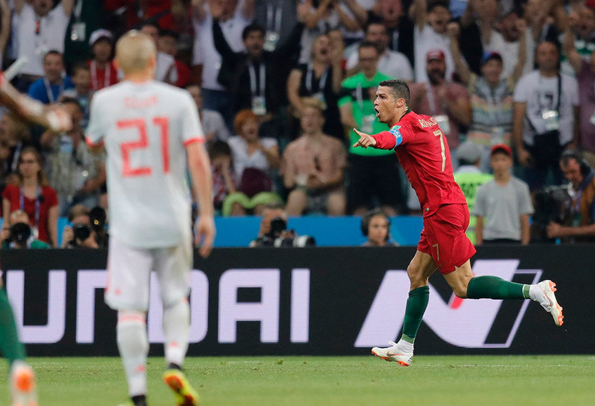 Sochi (Russian Federation), 15/06/2018.- Cristiano Ronaldo (R) of Portugal celebrates after scoring the 2-1 lead during the FIFA World Cup 2018 group B preliminary round soccer match between Portugal and Spain in Sochi, Russia, 15 June 2018. (RESTRICTIONS APPLY: Editorial Use Only, not used in association with any commercial entity - Images must not be used in any form of alert service or push service of any kind including via mobile alert services, downloads to mobile devices or MMS messaging - Images must appear as still images and must not emulate match action video footage - No alteration is made to, and no text or image is superimposed over, any published image which: (a) intentionally obscures or removes a sponsor identification image; or (b) adds or overlays the commercial identification of any third party which is not officially associated with the FIFA World Cup) (España, Mundial de Fútbol, Rusia) EFE/EPA/RONALD WITTEK EDITORIAL USE ONLY