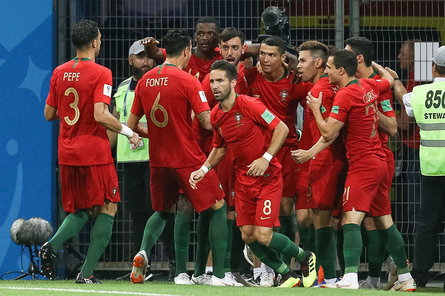 FWC04-23. Sochi (Russian Federation), 15/06/2018.- Cristiano Ronaldo (3-R) of Portugal celebrates with his team mates after scoring against Spain during the FIFA World Cup 2018 group A preliminary round soccer match between Portugal and Spain at the Fisht Stadium, in Sochi, Russia, 15 June 2018.  (RESTRICTIONS APPLY: Editorial Use Only, not used in association with any commercial entity - Images must not be used in any form of alert service or push service of any kind including via mobile alert services, downloads to mobile devices or MMS messaging - Images must appear as still images and must not emulate match action video footage - No alteration is made to, and no text or image is superimposed over, any published image which: (a) intentionally obscures or removes a sponsor identification image; or (b) adds or overlays the commercial identification of any third party which is not officially associated with the FIFA World Cup) (España, Mundial de Fútbol, Rusia) EFE/EPA/PAULO NOVAIS EDITORIAL USE ONLY