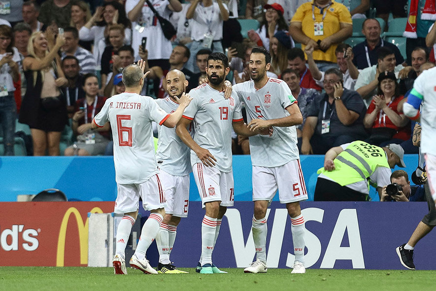 FWC04-23. Sochi (Russian Federation), 15/06/2018.- Diego Costa (2-R) of Spain celebrates with his teammates after scoring a goal against Portugal during the FIFA World Cup 2018 group A preliminary round soccer match between Portugal and Spain at the Fisht Stadium, in Sochi, Russia, 15 June 2018.  (RESTRICTIONS APPLY: Editorial Use Only, not used in association with any commercial entity - Images must not be used in any form of alert service or push service of any kind including via mobile alert services, downloads to mobile devices or MMS messaging - Images must appear as still images and must not emulate match action video footage - No alteration is made to, and no text or image is superimposed over, any published image which: (a) intentionally obscures or removes a sponsor identification image; or (b) adds or overlays the commercial identification of any third party which is not officially associated with the FIFA World Cup) (España, Mundial de Fútbol, Rusia) EFE/EPA/PAULO NOVAIS EDITORIAL USE ONLY