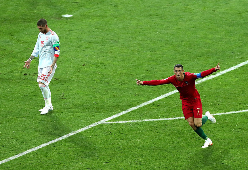 Sochi (Russian Federation), 15/06/2018.- Cristiano Ronaldo of Portugal (R) celebrates scoring the 2-1 as Sergio Ramos is dejected during the FIFA World Cup 2018 group B preliminary round soccer match between Portugal and Spain in Sochi, Russia, 15 June 2018. (RESTRICTIONS APPLY: Editorial Use Only, not used in association with any commercial entity - Images must not be used in any form of alert service or push service of any kind including via mobile alert services, downloads to mobile devices or MMS messaging - Images must appear as still images and must not emulate match action video footage - No alteration is made to, and no text or image is superimposed over, any published image which: (a) intentionally obscures or removes a sponsor identification image; or (b) adds or overlays the commercial identification of any third party which is not officially associated with the FIFA World Cup) (España, Mundial de Fútbol, Rusia) EFE/EPA/MOHAMED MESSARA EDITORIAL USE ONLY EDITORIAL USE ONLY