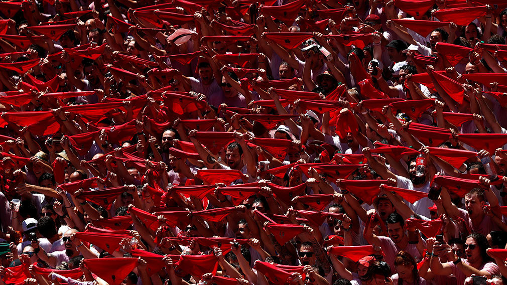 Revellers hold up the traditional red scarves during the firing of 'chupinazo', which opens the San Fermin festival in Pamplona Spain, July 6, 2019.