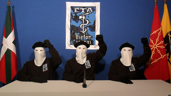 "UNSPECIFIED - UNDATED:  In this undated image provided by Gara, three Eta militants pose in front of the group's symbol of a snake coiled around an axe, in support of a declaration released on October 20, 2011 stating a ""definitive cessation"" to it's four decade long campaign of armed conflict in seeking an independent Basque homeland from Spain and France.  (Photo released by Gara via Getty Images)"