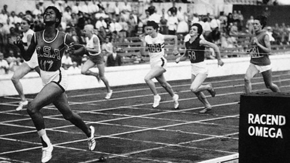 03 Sep 1960, Rome, Italy --- American Wilma Rudolph crosses the finish line in a women's sprint event at the 1960 Summer Olympics in Rome, Italy. September 3, 1960. --- Image by © Bettmann/CORBIS