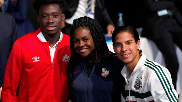 Moscow (Russian Federation), 13/06/2018.- Canadian international player Alphonso Davis (L), Diego Lainez (R), member of the Mexico men's Under-21 team and Brianna Pinto, member of the US Under-20 women team wait to enter the stage for their presentat