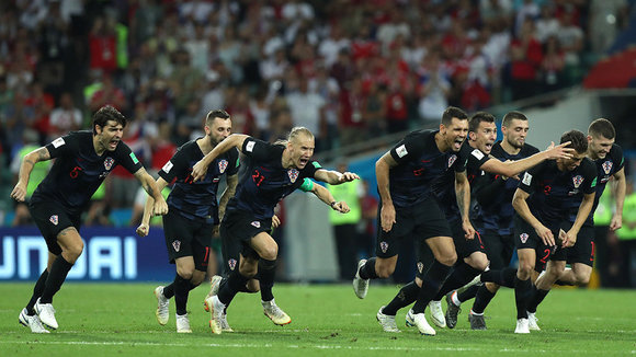 Sochi (Russian Federation), 07/07/2018.- Players of Croatia celebrate winning the penalty shoutout of the FIFA World Cup 2018 quarter final soccer match between Russia and Croatia in Sochi, Russia, 07 July 2018. (RESTRICTIONS APPLY: Editorial Use Only, not used in association with any commercial entity - Images must not be used in any form of alert service or push service of any kind including via mobile alert services, downloads to mobile devices or MMS messaging - Images must appear as still images and must not emulate match action video footage - No alteration is made to, and no text or image is superimposed over, any published image which: (a) intentionally obscures or removes a sponsor identification image; or (b) adds or overlays the commercial identification of any third party which is not officially associated with the FIFA World Cup) (Croacia, Mundial de Fútbol, Rusia) EFE/EPA/MOHAMED MESSARA EDITORIAL USE ONLY