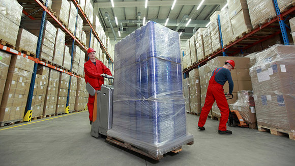 Logistics,two workers working in storehouse