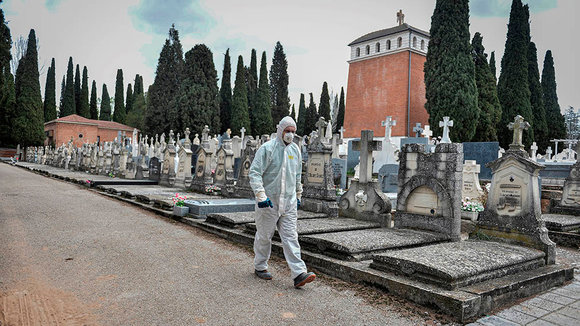 A worker from Guadalajara's City Hall wears a protective dress and a mask at Guadalajara's cemetery in Spain, 27 March 2020. Guadalajara's City Hall will build urgently 44 new graves due to coronavirus crisis outbreak. EFE/Nacho Izquierdo