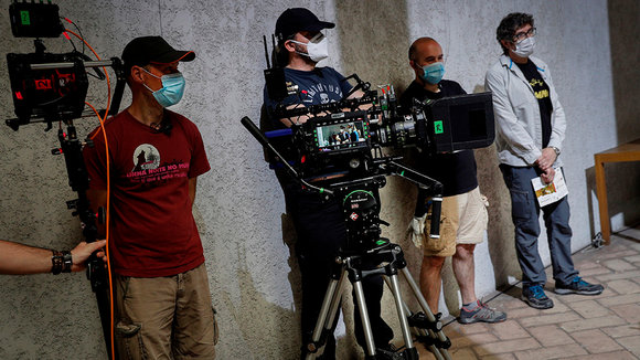 The director of the series 'Tres Caminos' (lit. Three Ways), Norberto Lopez (R), and other members of his team wear facial protective masks during the filming of the Amazon Prime Video, Ficcion Producciones and Beta Films joint production at Condestable Palace in Pamplona, Spain, 26 May 2020. The series narrates the story of five people of different nationalities that become friends as they walk St James' Way. EFE/ Villar Lopez