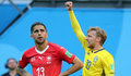 St.petersburg (Russian Federation), 03/07/2018.- Emil Forsberg of Sweden (R) reacts after scoring the 1-0 as Ricardo Rodriguez of Switzerland looks dejected during the FIFA World Cup 2018 round of 16 soccer match between Sweden and Switzerland in St.Petersburg, Russia, 03 July 2018. (RESTRICTIONS APPLY: Editorial Use Only, not used in association with any commercial entity - Images must not be used in any form of alert service or push service of any kind including via mobile alert services, downloads to mobile devices or MMS messaging - Images must appear as still images and must not emulate match action video footage - No alteration is made to, and no text or image is superimposed over, any published image which: (a) intentionally obscures or removes a sponsor identification image; or (b) adds or overlays the commercial identification of any third party which is not officially associated with the FIFA World Cup) (Mundial de Fútbol, Suecia, Suiza, Rusia) EFE/EPA/GEORGI LICOVSKI EDITORIAL USE ONLY