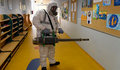 08 March 2020, Czech Republic, Prague: A man in a protective suit disinfects a corridor inside a school amid the coronavirus (Covid-19) outbreak in Prague. Photo: Michal Krumphanzl/CTK/dpa ONLY FOR USE IN SPAIN  08 March 2020, Czech Republic, Prague: A man in a protective suit disinfects a corridor inside a school amid the coronavirus (Covid-19) outbreak in Prague. Photo: Michal Krumphanzl/CTK/dpa  3/8/2020 ONLY FOR USE IN SPAIN