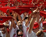 Revellers hold up traditional red scarves during the start of the San Fermin festival in Pamplona, Spain July 6, 2016. REUTERS/Eloy AlonsoCODE: X01457