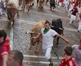 A runner sprints in front of Fuente Ymbro fighting bulls at the Estafeta corner during the first running of the bulls at the San Fermin festival in Pamplona, northern Spain, July 7, 2016. REUTERS/Vincent WestCODE: X00957