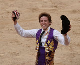Spanish bullfighter Roman shows a bull's ear awarded to him following a bullfight at the San Fermin festival in Pamplona, Spain, July 7, 2017. REUTERS/Vincent WestCODE: X00957